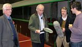 Chris, Des and Paul with Conor showing them a real tennis racket