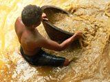 Washing gem gravel at a mine in Sri Lanka