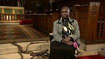 Black priest walks in 'slave' chains