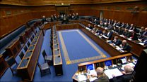 MLAs walk out as Foster begins statement
