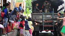 Evacuations in Philippines as typhoon strikes