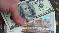 Би-Би-Сиз: Ўзбек сўми ва долларни нима кутмоқда?
