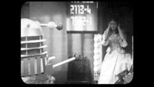 A Dalek Orders Victoria onto a Weighing Device