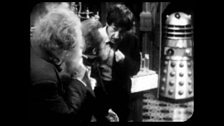 A Dalek Appears Behind the Doctor