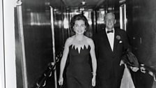 Alistair and Jane Cooke heading out to dinner, aboard the Queen Mary, 1970s