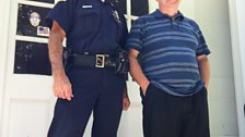 Ian with Police Chief Rick Wilcox outide the old poice station where Officer Obie arrested Arlo.