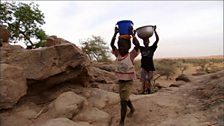Image for Collecting and carrying water from a well in Mali, Africa