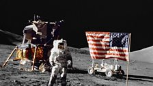 Apollo 17 landing module, astronaut and exploratory rover on lunar soil