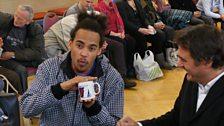 Dev shows off his Radio 1 mug!