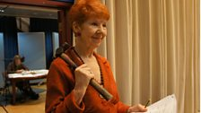 The Red Queen, played by Carole Boyd, gets ready to hammer in the pegs
