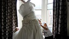 Host Andrina alters wedding dresses. So naturally Greg had to try one on!
