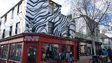 'You know. By the shop that looks like a zebra. By the chippie.'