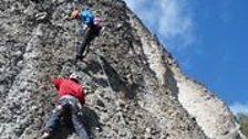 Red Szell climbing