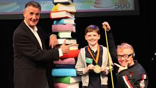 Bronze 9 & Under winner Christian Morton with Chris and Michael Palin, who read his story 'Stone Age Steve and the Dragon'
