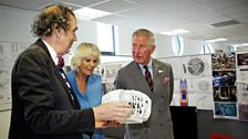 Their Royal Highnesses meet Michael Pickwoad (Production Designer) who shows them a model of the TARDIS.
