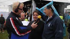 Jody Scheckter and James Martin dodge the rain with Chris