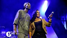Wretch 32 and backing vocalist