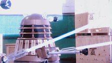 The Daleks open fire!