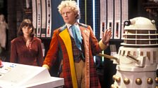 The Sixth Doctor is covered by a Dalek…