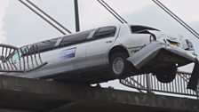 Image for How do you hang a limousine off a bridge?