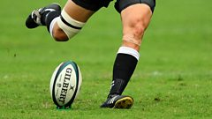 Rugby player kicking a rugby ball