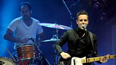 The Killers talk about sounding English and performing live