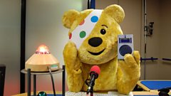 Pudsey shows off the prototype for the winning radio design.