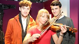 Image for Thursday: Clean Bandit teach Sara the violin