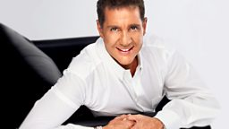 Image for Dale Winton sits in