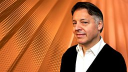 Image for Mark Goodier sits in