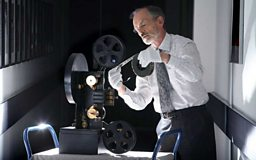 Michael Harvey with film and projector