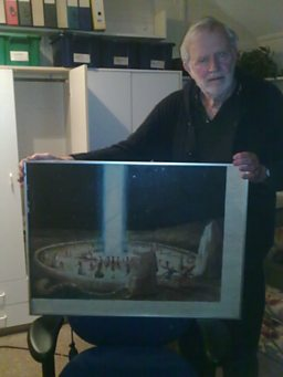 Co-creator Jeremy Burnham holds a copy of the painting 'Quod Non Est'