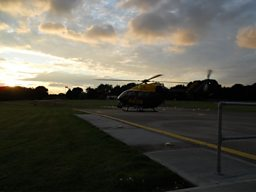 The crew has received a call from a unit in the city and the helicopter takes off to assist at dusk