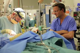 Plastic surgeon operates on a patient in Afghanistan