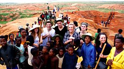 Photo: The group with locals at the sapphire mine, Madagascar