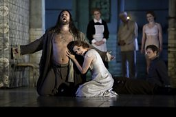 Johan Reuter as Jokanaan & Angela Denoke as Salome (background: Sarah Castle as Page of Herodias)