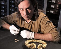 Neil examines gold jewellery and early coins