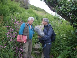 Archaeologist Graeme Kirkham explaining the history of the flower fields to producer, Julian May