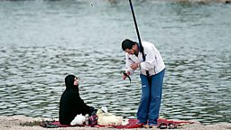 A man and a woman fishing on the Wadi Hanifah