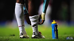 Lucozade sport on playing field