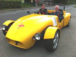 John Craven with John Lilly in an electric car