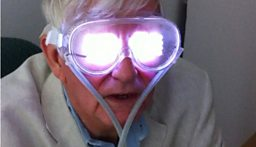 Geoff Watts in Dominic Ffytches lab, wearing a device that stimulates hallucinations