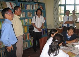Photograph of Tsering on a field visit to Namgyal Higher Secondary School in Nepal