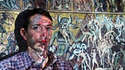 Alastair Sooke in front of a projected image of Coppo di Marcovaldo's 'Last Judgement'.