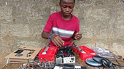 Kelvin Doe working on his FM radio transmitter