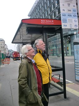 Christopher and Terry waiting for a bus to continue their journey