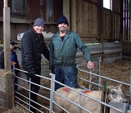 Tom with sheep farmer