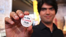Alok Jha holding a Science Club badge