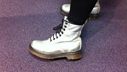 Jackie wore these shiny boots to meet Jonathan and ask for help with her son's HGV course