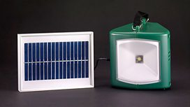 Solar-powered lamp and charger